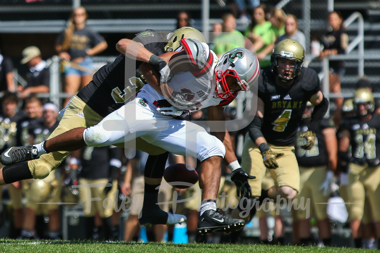 Brown University running back David Moodie (32) Bryant University linebacker Thomas Costigan (32)