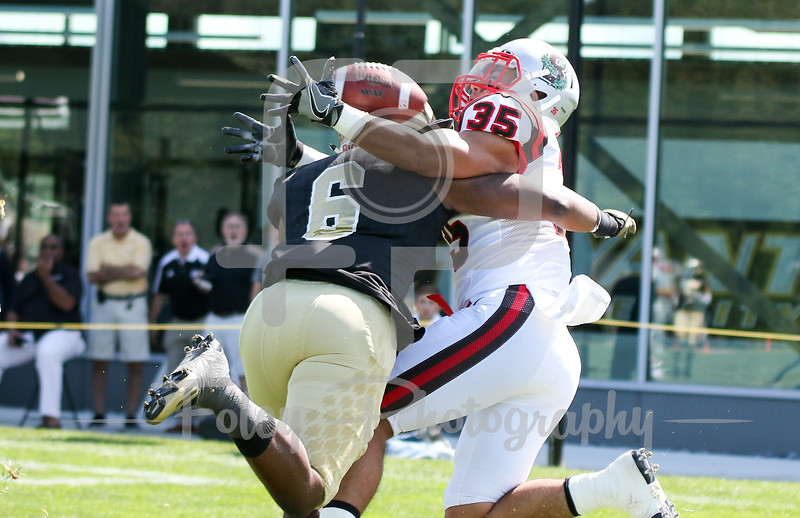 Brown Bears running back Johnny Pena (35) Bryant University Bulldogs defensive back Brandon Owens (6)