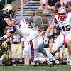 Bryant University Bulldogs wide receiver Elo Deneus (21) Brown Bears safety Connor Coughlin (3)