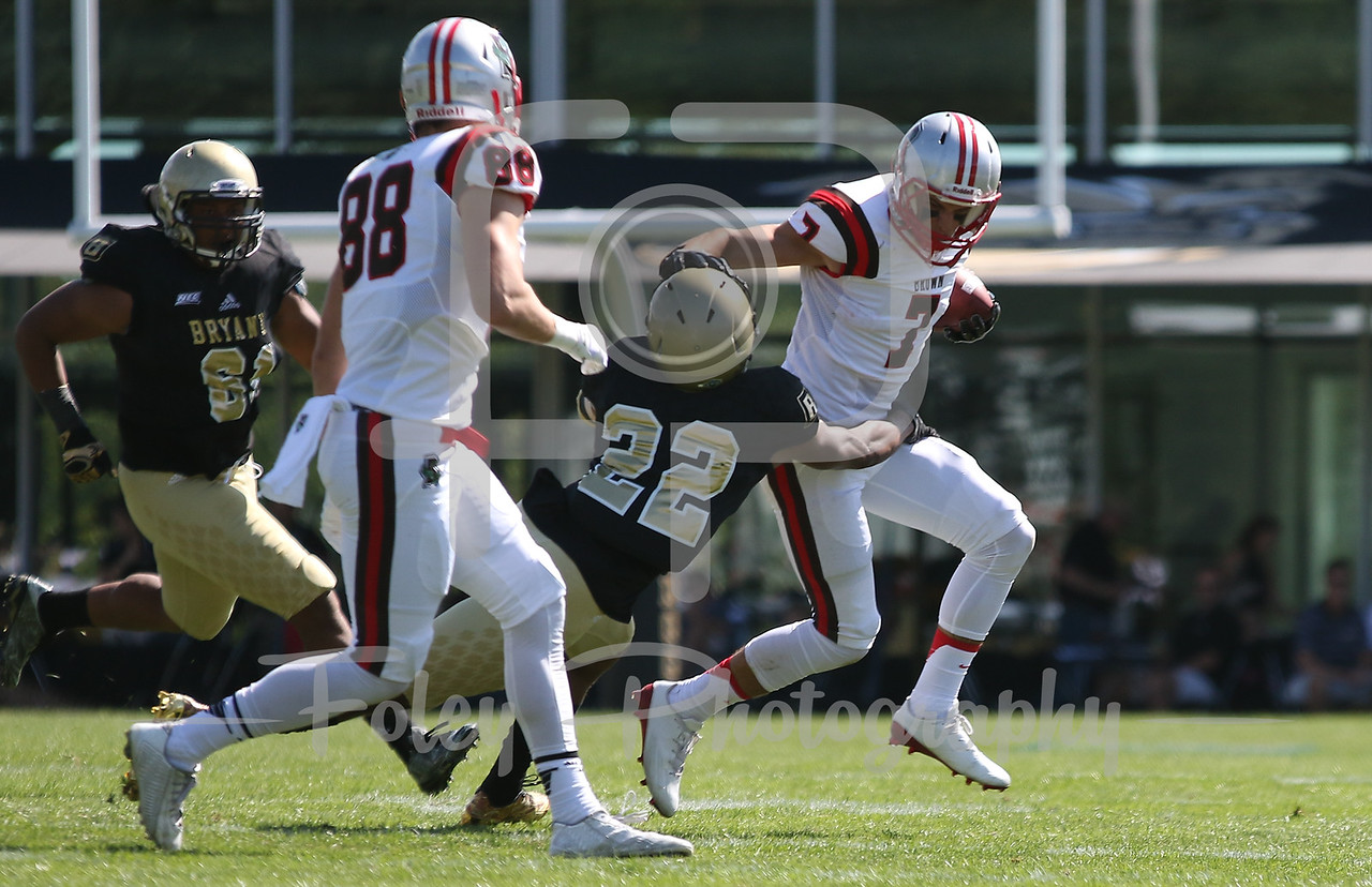 Brown Bears wide receiver Alexander Jette (7) Bryant University Bulldogs linebacker Thomas Costigan (32)