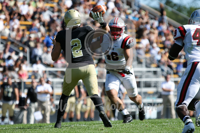 Bryant University Bulldogs quarterback Dalton Easton (2) Brown Bears linebacker William Twyman (46)