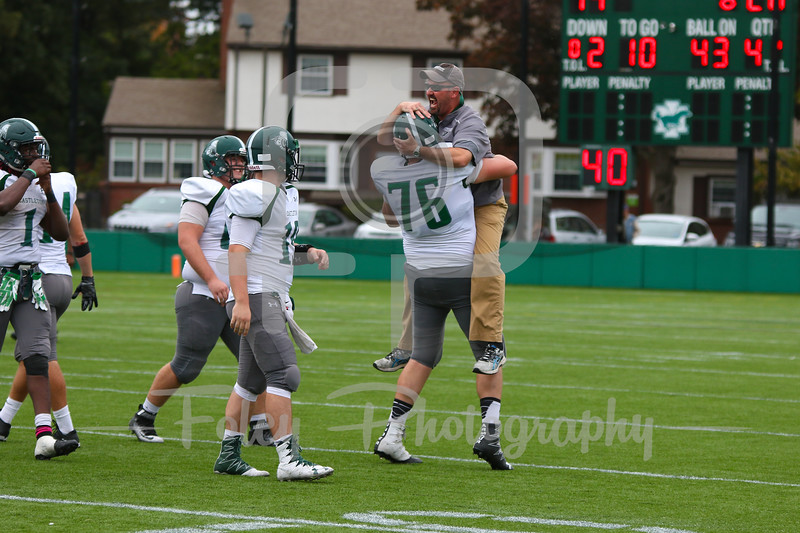 Castleton University head coach Tony Volpone Castleton University offensive lineman Jesse Bekefi (76)