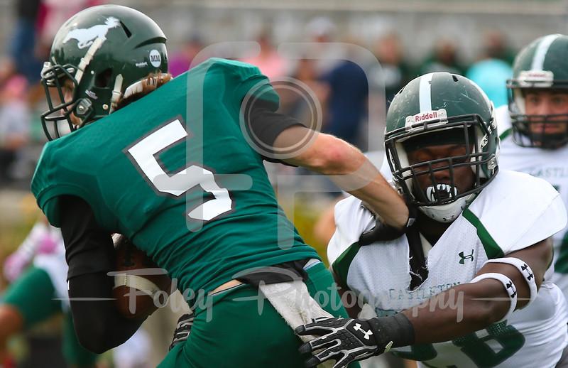 Mount Ida Mustangs Matt Greenman (5) Castleton University linebacker Joel Antoine (28)