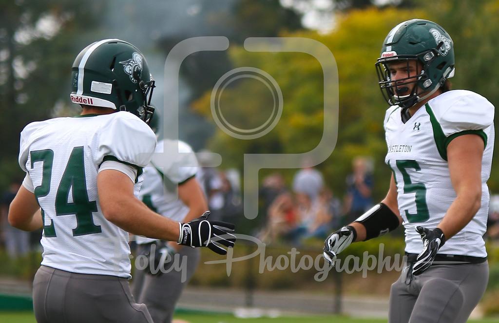 Castleton University quarterback Ian Curtin (15)