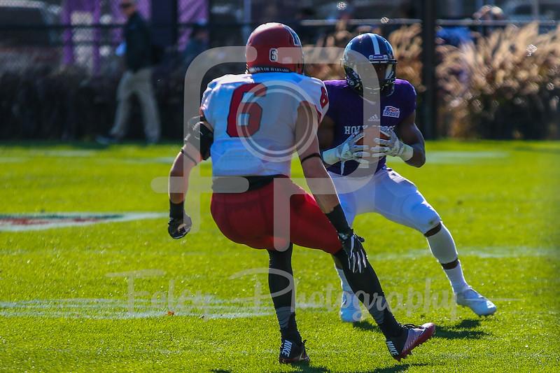 Holy Cross Crusaders wide receiver Domenic Cozier (1) Harvard Crimson quarterback Cam Tripp (8)