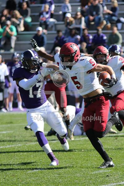 Harvard Crimson running back Alex LaPolice (5) Holy Cross Crusaders defensive back Damion Baker (17)