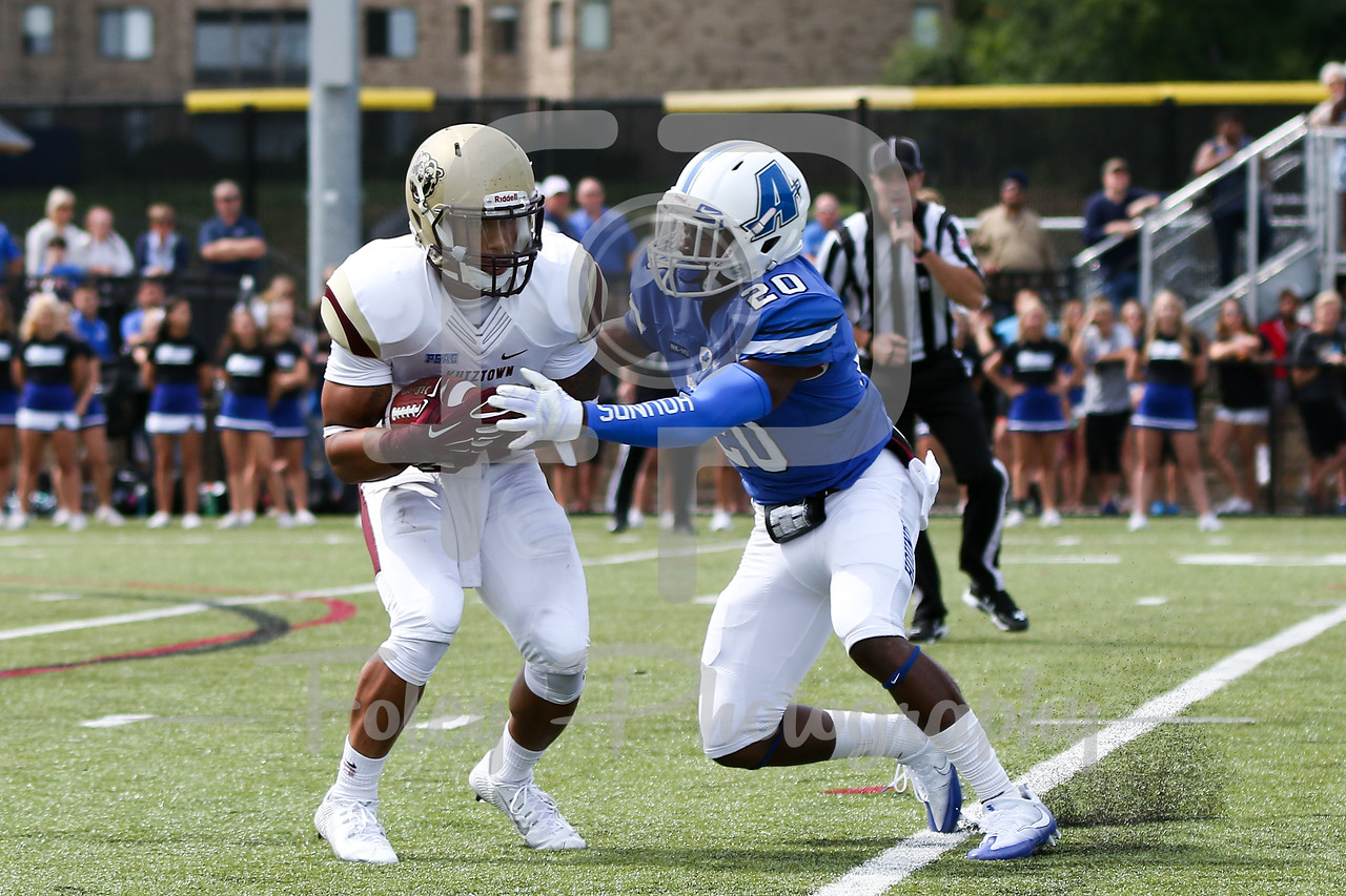 Kutztown Golden Bears running back Craig Reynolds (13) Assumption College Stephon Hill (20)