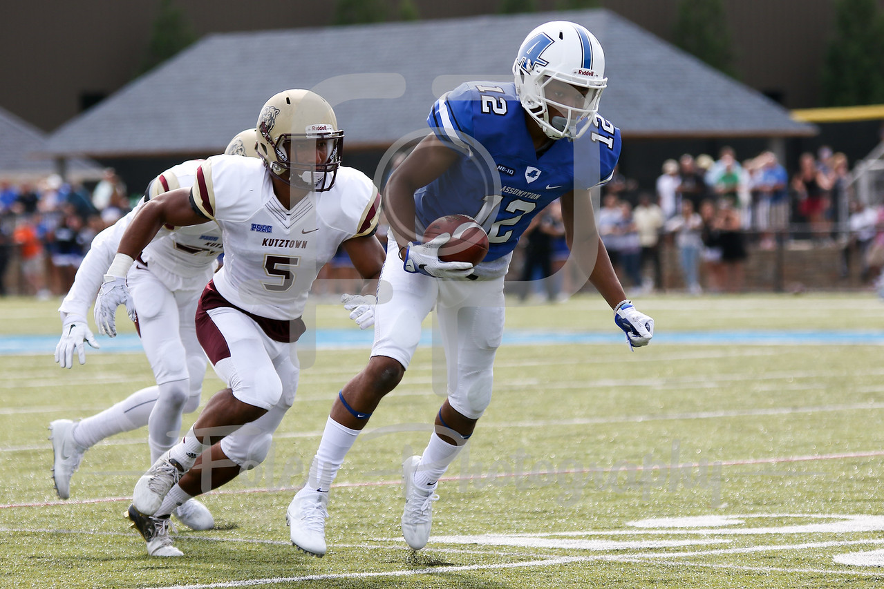 Kutztown Golden Bears defensive back Jake Perry (5) Assumption College Junior Oyaronbi (12)