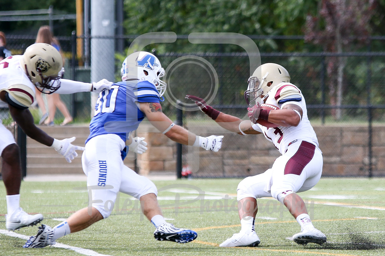 Kutztown Golden Bears running back Craig Reynolds (13) Assumption College Dylan Oxsen (30)
