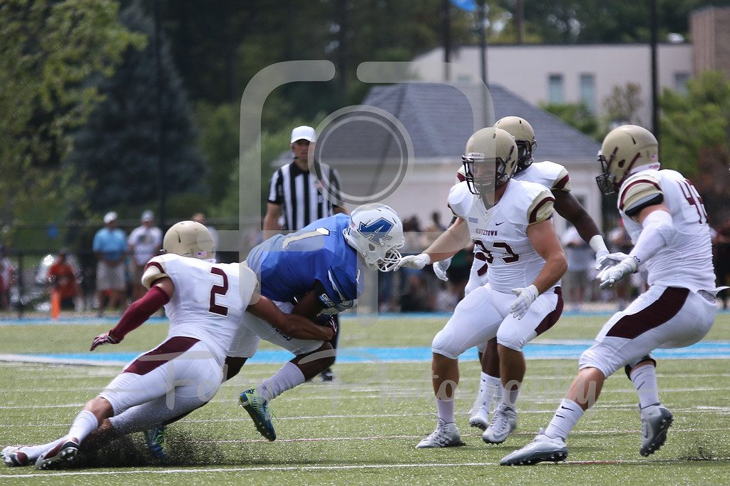 Assumption College Deonte Harris (1) Kutztown Golden Bears safety Kenny Williams (2)