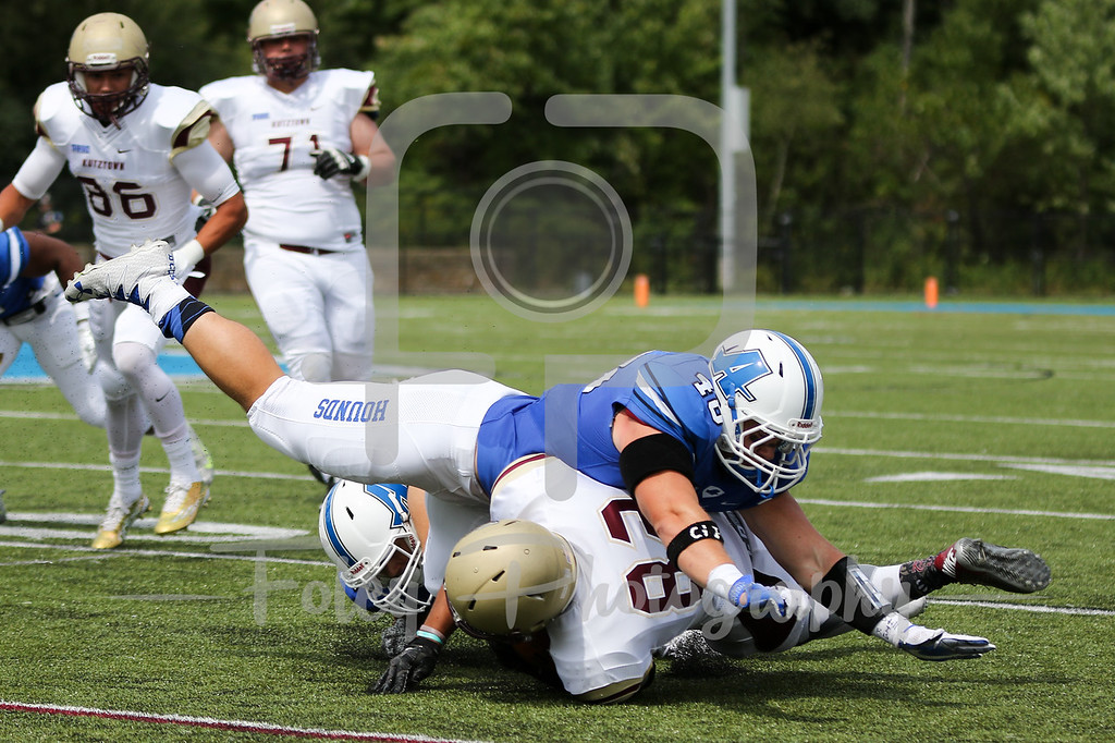 Kutztown Golden Bears wide receiver Kellen Williams (82) Assumption College Levi Fancher (48)