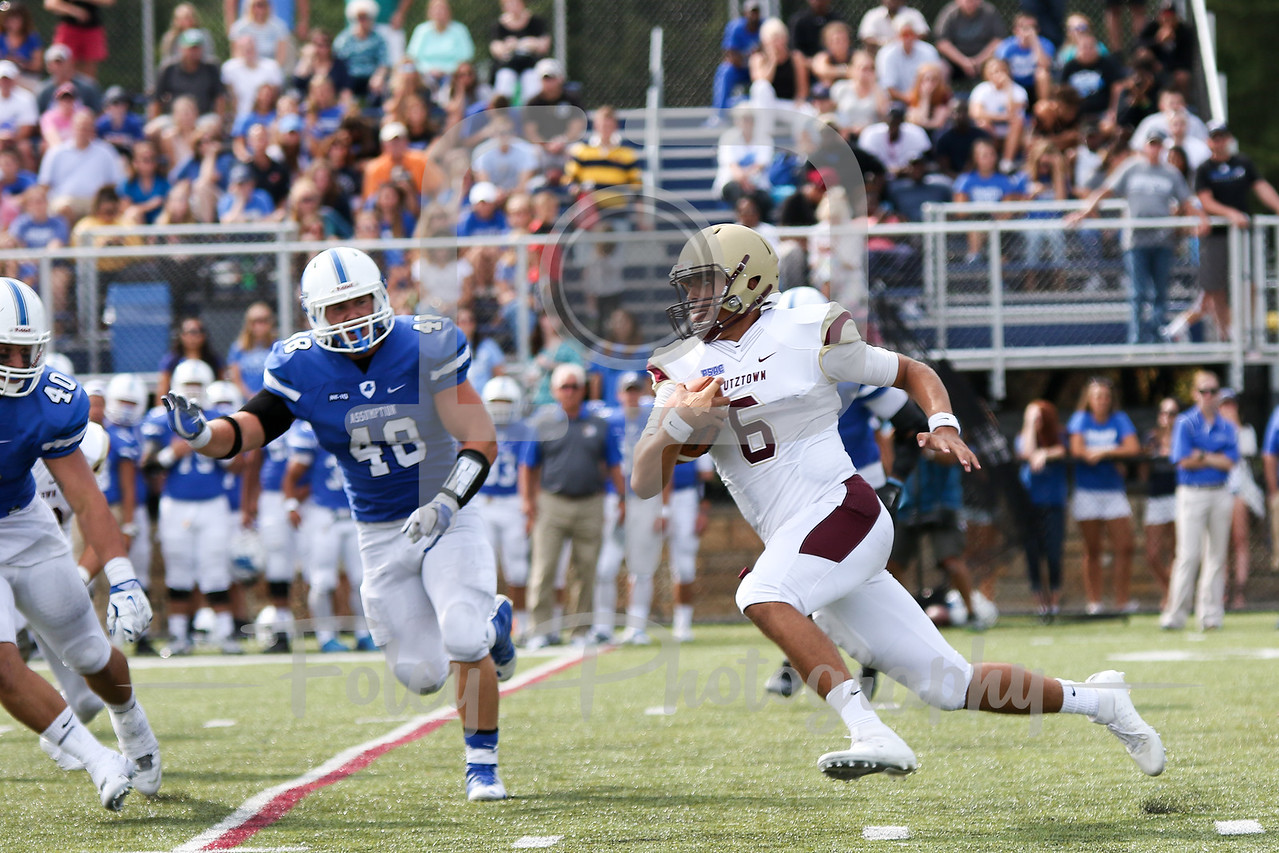 Kutztown Golden Bears quarterback Terence Scanlon (6) Assumption College Nick Valenti (40)