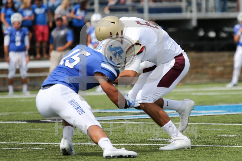 Kutztown Golden Bears quarterback Terence Scanlon (6) Assumption College Jarrod Casey (15)
