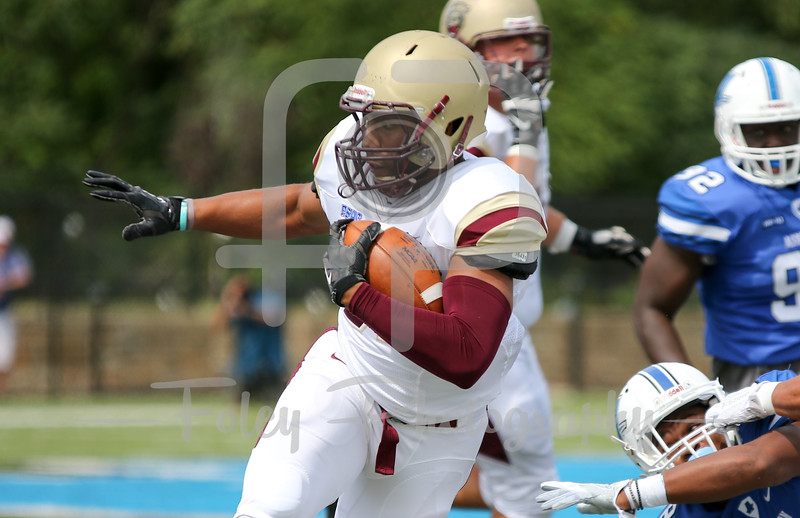 Kutztown Golden Bears wide receiver Kellen Williams (82) Assumption College Charles Reid (8)
