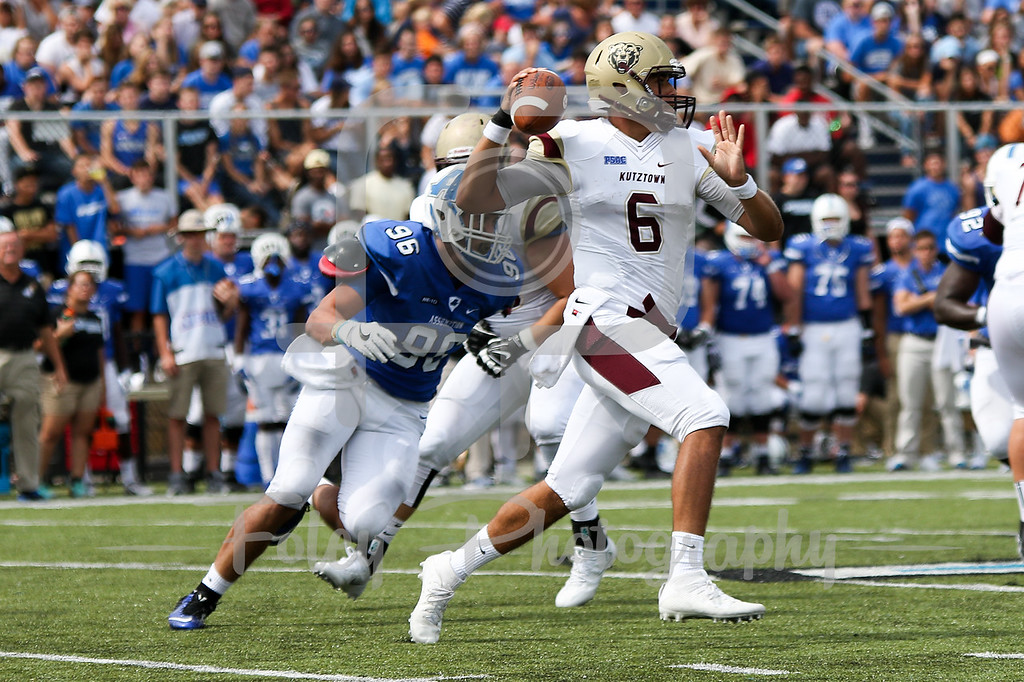 Kutztown Golden Bears quarterback Terence Scanlon (6) Assumption College Joe Bruno (96)