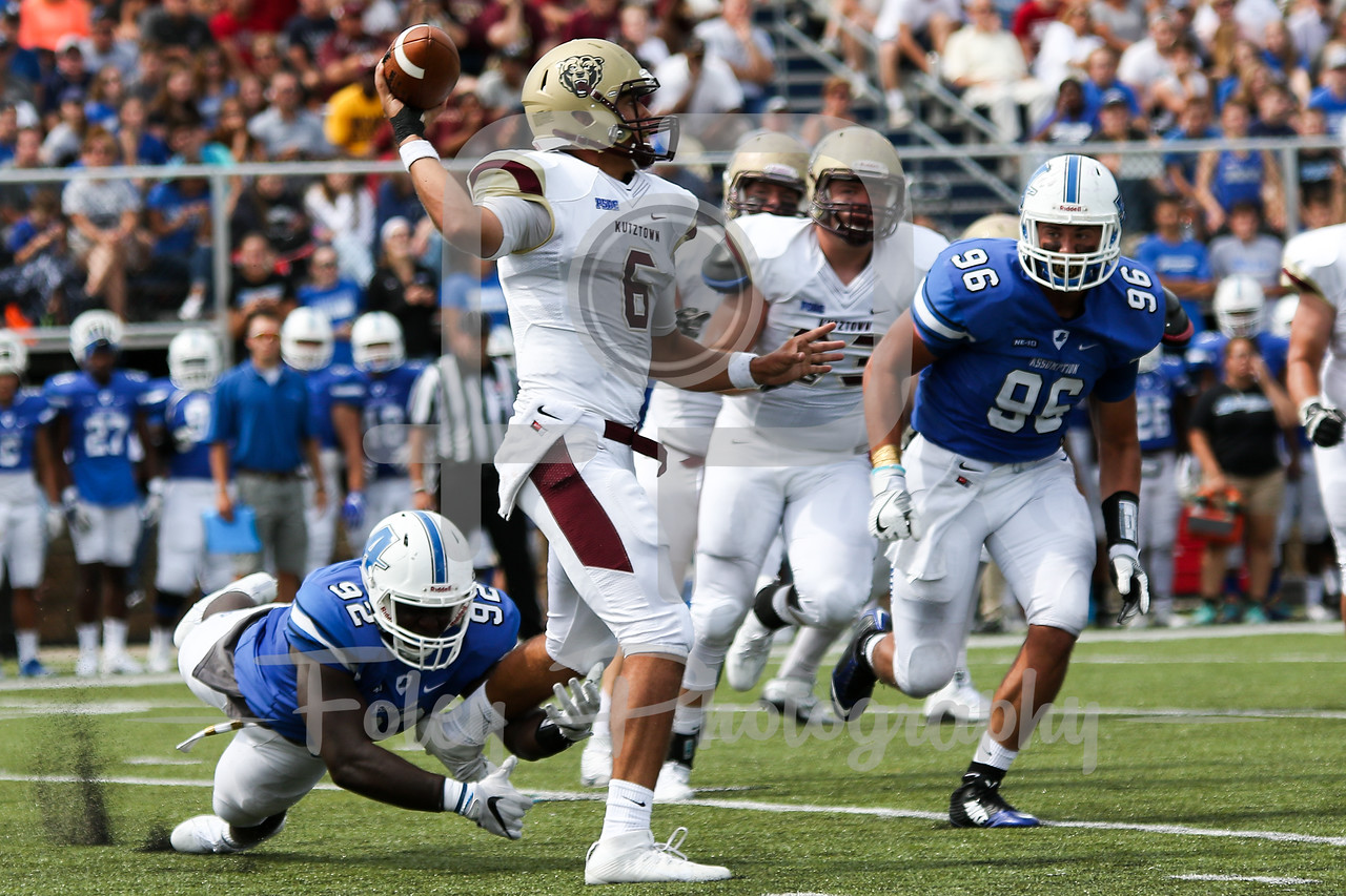 Assumption College Ray Sarkodieh (92) Kutztown Golden Bears quarterback Terence Scanlon (6)