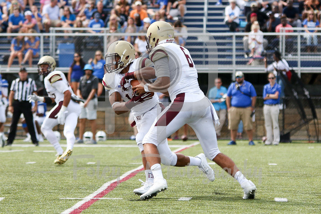 Kutztown Golden Bears quarterback Terence Scanlon (6) Kutztown Golden Bears running back Craig Reynolds (13)