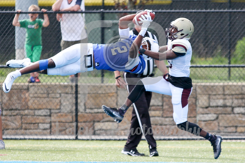 Assumption College Ashton Grant (2) Kutztown Golden Bears cornerback Lance Deane Jr. (15)