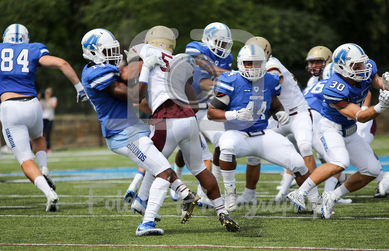 Assumption College Shawn Springs Jr. (13) Kutztown Golden Bears defensive back Jake Perry (5)