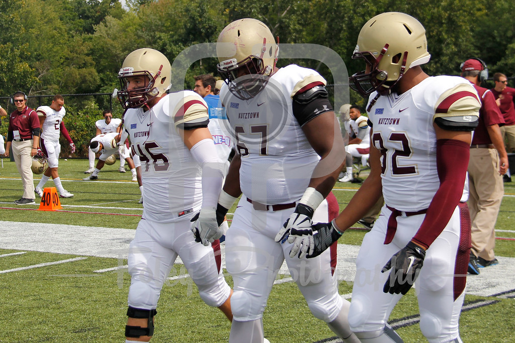 Kutztown Golden Bears linebacker Zack Delp (46) Kutztown Golden Bears offensive lineman Jordan Morgan (67) Kutztown Golden Bears wide receiver Kellen Williams (82)