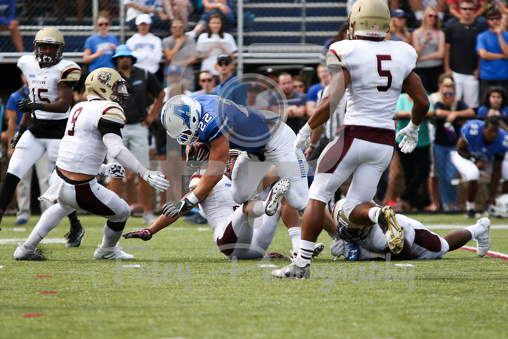Assumption College Alex Shain (22) Kutztown Golden Bears safety Jalen Nieves (9)