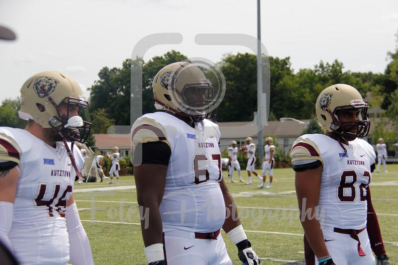 Kutztown Golden Bears linebacker Zack Delp (46) Kutztown Golden Bears offensive lineman Jordan Morgan (67) Kutztown Golden Bears wide receiver Kellen Williams (82)