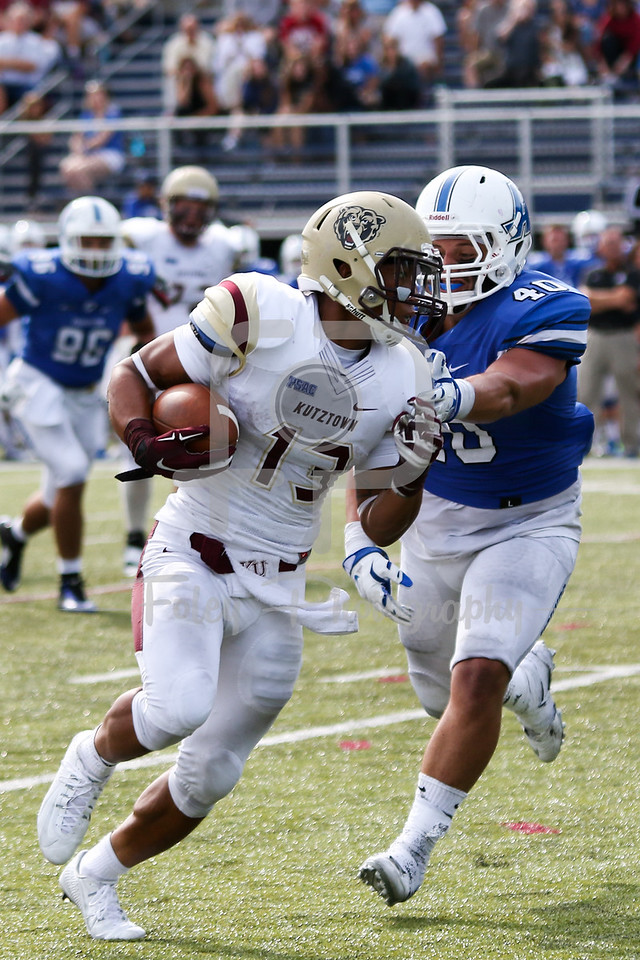 Kutztown Golden Bears running back Craig Reynolds (13) Assumption College Nick Valenti (40)