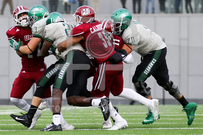 Massachusetts Minutemen linebacker Colbert Calhoun (35) Wagner Seahawks running back Denzel Knight (28)