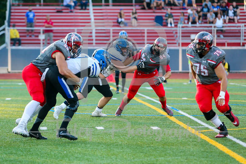 WPI Engineers Luca Cerasani (99) Becker College Hawks quarterback Nas Sinkfield-Shelton (7)