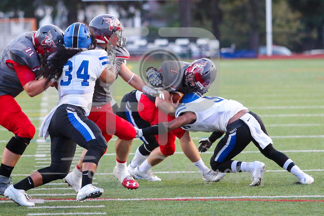 WPI Engineers Connor Field (7) Becker College Hawks defensive back Shahiem Wilson (9)