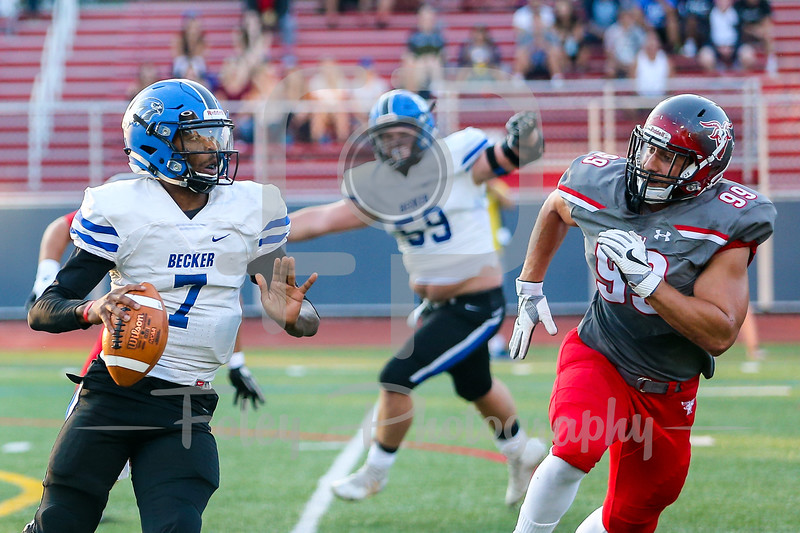Becker College Hawks quarterback Nas Sinkfield-Shelton (7) WPI Engineers Luca Cerasani (99)