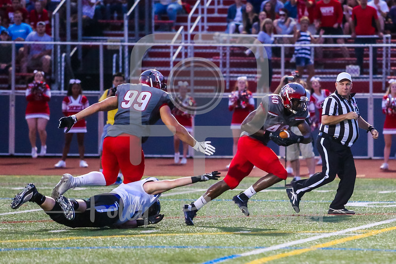 Becker College Hawks offensive lineman Zachary Larkin (66) WPI Engineers Francis Lubega (40)