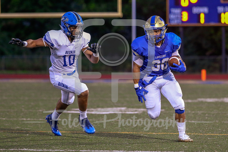 Worcester State Lancers running back Hunter Paupaw (30) Becker College Hawks linebacker Christian Perkins (10)
