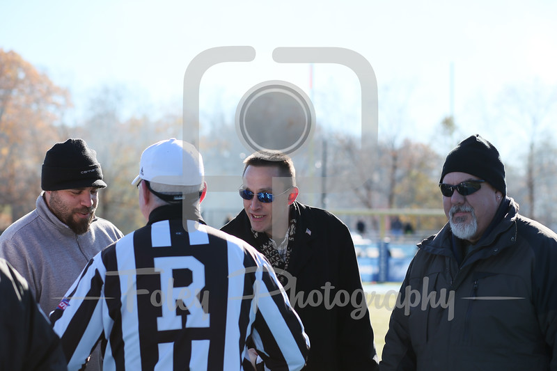 Nov. 11, 2017, Multi-Sport Stadium, Worcester, MA: Referee shakes hands with veterans before the Falcons 35-31 victory over the Greyhounds in a Northeast-10 Conference matchup.