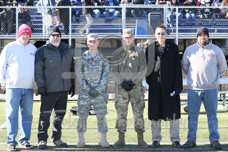 Nov. 11, 2017, Multi-Sport Stadium, Worcester, MA: A bunch of US Armed Services Veterans pose for a picture before the Falcons 35-31 victory over the Greyhounds in a Northeast-10 Conference matchup.