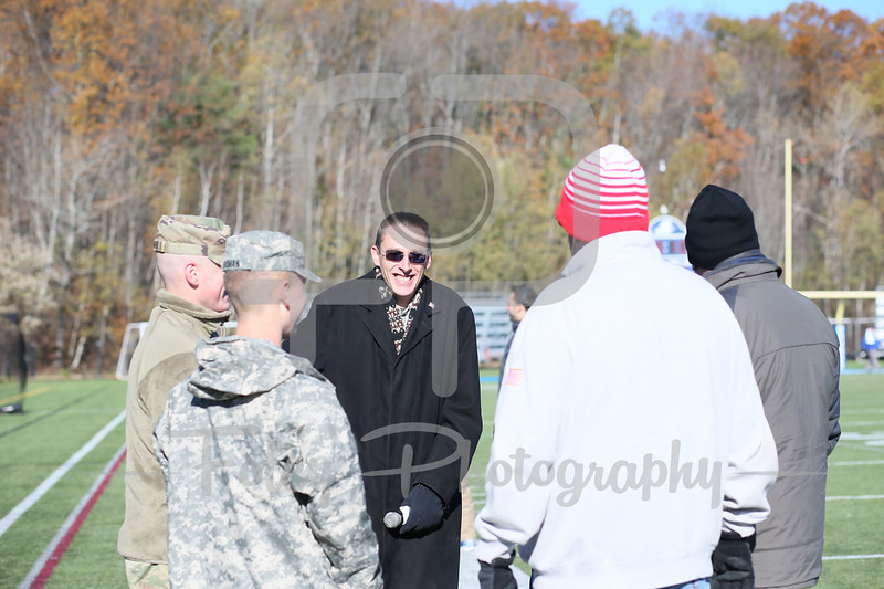 Nov. 11, 2017, Multi-Sport Stadium, Worcester, MA: A bunch of US Armed Services Veterans chat before the Falcons 35-31 victory over the Greyhounds in a Northeast-10 Conference matchup.