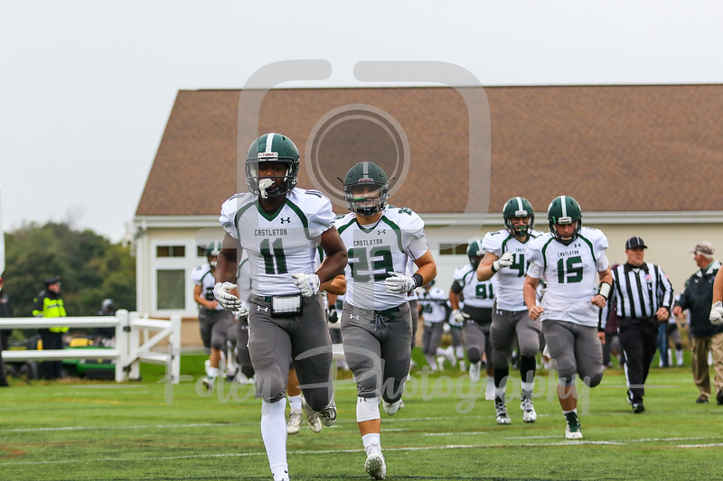 Castleton University Spartans wide receiver Adnane Adossama (11) Castleton University Spartans linebacker Will Mossop (23) Castleton University Spartans quarterback Mitchell Caron (15)
