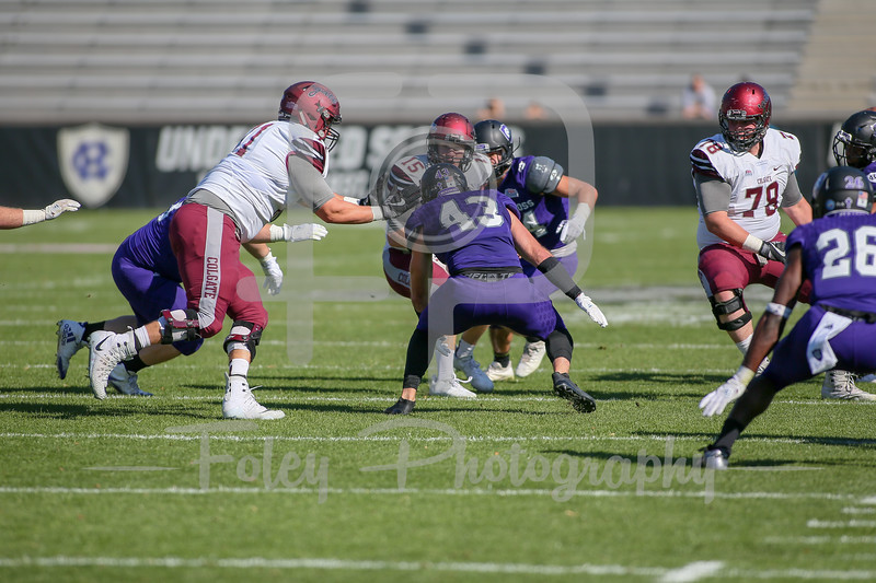 Colgate Raiders quarterback Grant Breneman (15) Holy Cross Crusaders linebacker Nick McBeath (43)