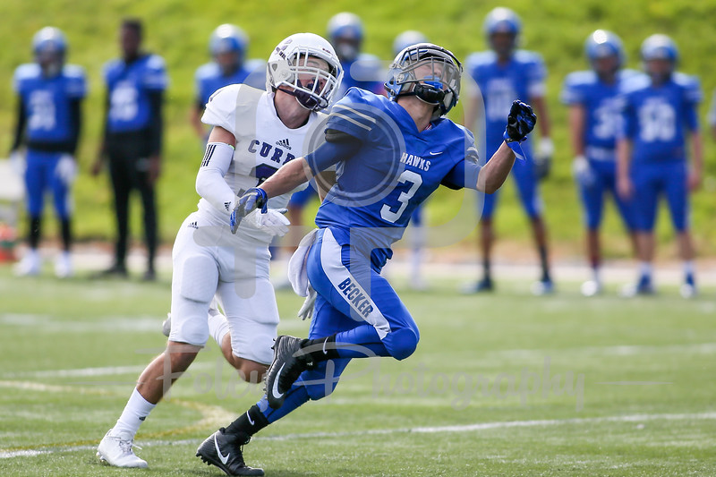 Becker College Hawks wide receiver Michael Caban (3) Curry College Colonels defensive back Jack O'Rourke (3)