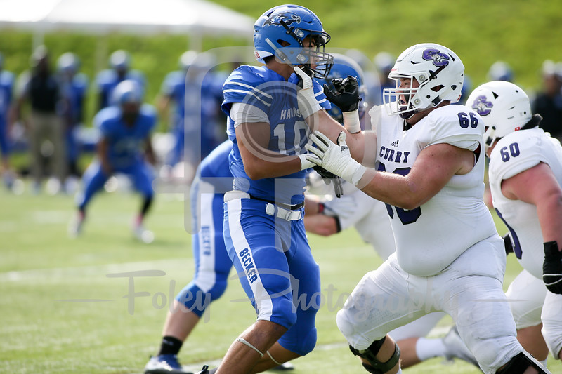 Curry College Colonels offensive lineman Timothy McGrath (66) Becker College Hawks defensive lineman Brandon Mole (8)