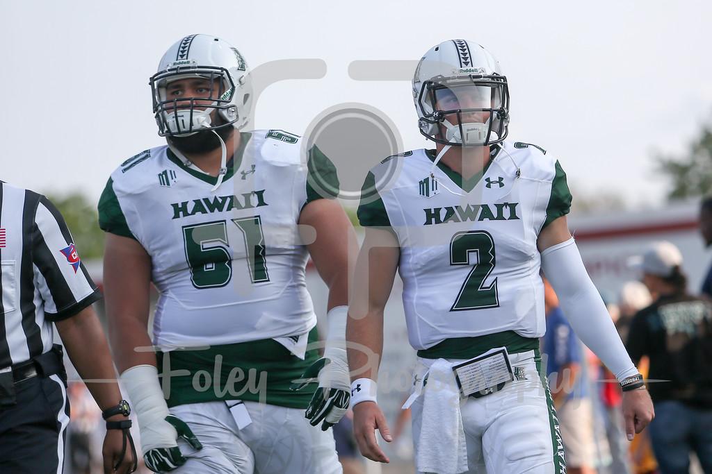 Hawaii Warriors quarterback Dru Brown (2) Hawaii Warriors offensive lineman John Wa'a (51)