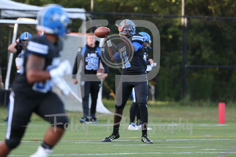 Becker College Hawks quarterback Alpha Barry (11)