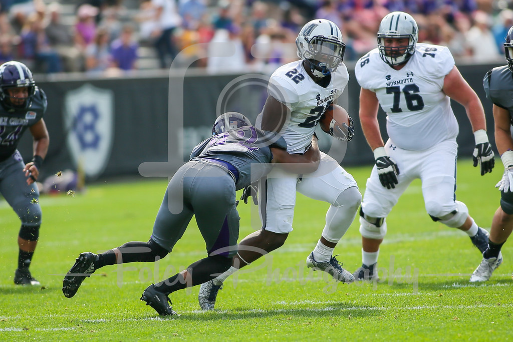 Monmouth Hawks running back Erik Zokouri (22) Holy Cross Crusaders defensive back Alex Johnson (22)