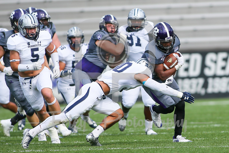 Holy Cross Crusaders running back Miles Alexander (9) Monmouth Hawks defensive back Mike Basile (30)