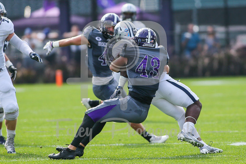 Holy Cross Crusaders linebacker Nick McBeath (43) Monmouth Hawks running back Erik Zokouri (22)