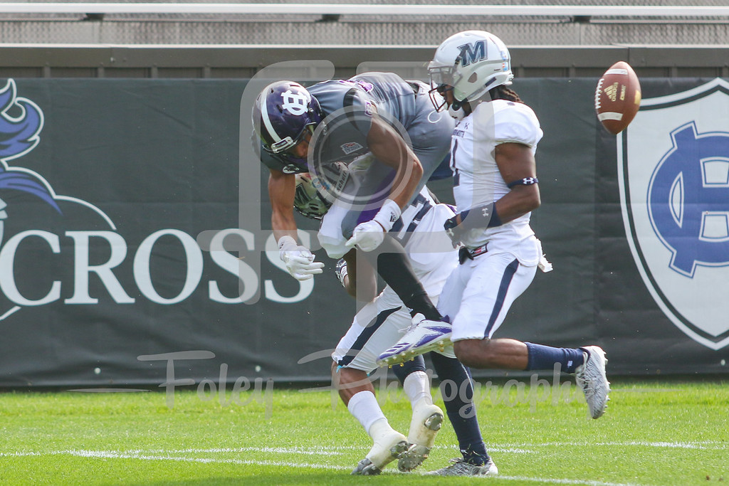 Holy Cross Crusaders wide receiver Martin Dorsey (84) Monmouth Hawks defensive back Teddie Martinez (23) Monmouth Hawks defensive back Tymere Berry (1)