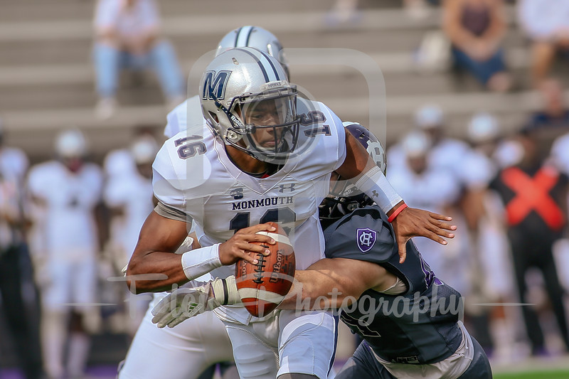 Monmouth Hawks quarterback Kenji Bahar (16) Holy Cross Crusaders linebacker Ryan Brady (44)