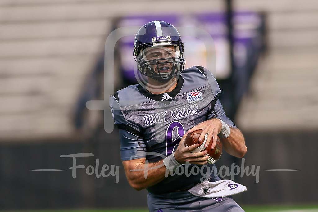 October 7, 2017, Fitton Field: Holy Cross Crusaders quarterback Peter Pujals (6) scrambles for a first down during the Hawks 48-36 over the Crusaders.