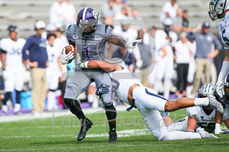 Holy Cross Crusaders running back Domenic Cozier (1) Monmouth Hawks defensive back Mike Basile (30)