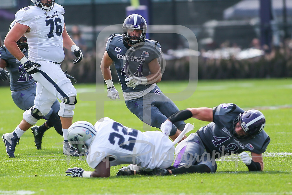 Monmouth Hawks running back Erik Zokouri (22) Holy Cross Crusaders linebacker Nick McBeath (43)